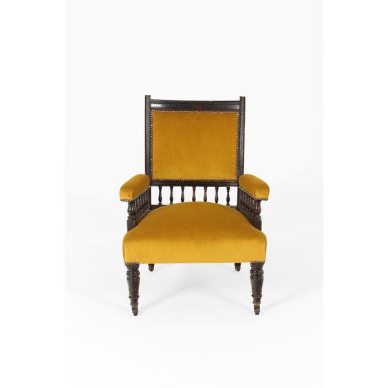 Vintage gold velvet spindle armchair image