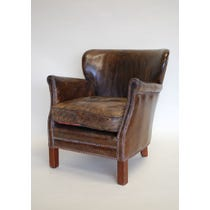 Brown leather studded armchair