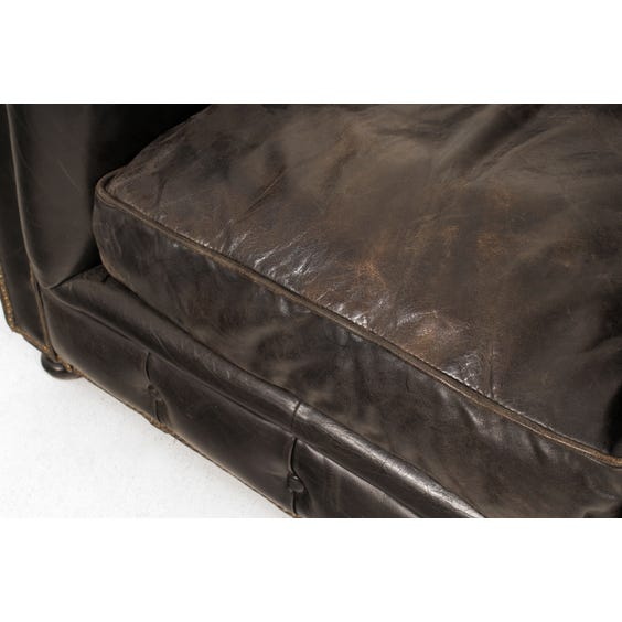 Aged black leather Chesterfield armchair image