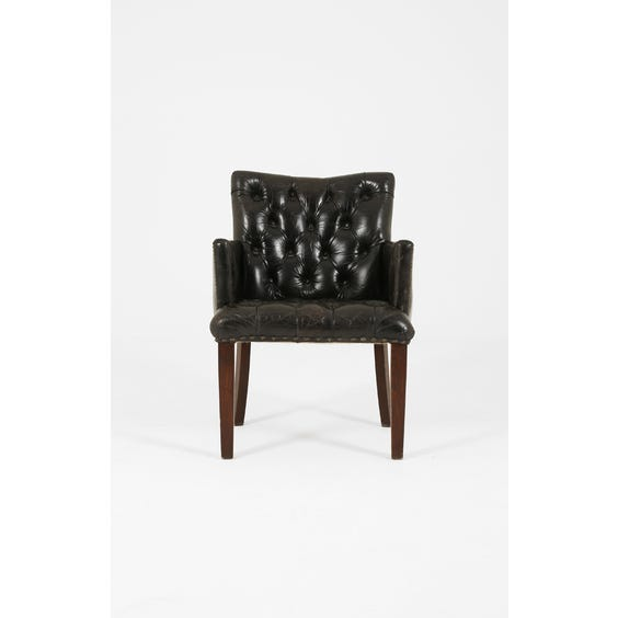 Black leather buttoned back armchair image