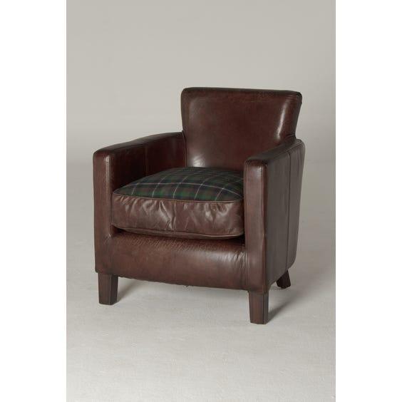 Brown leather armchair tartan cushion image