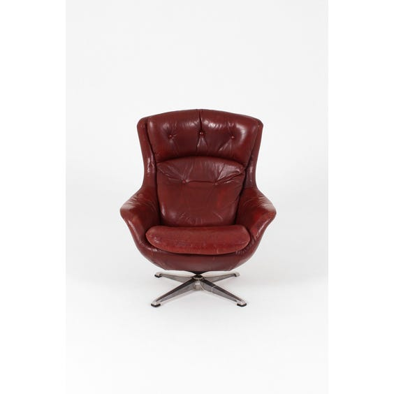 Vintage red leather swivel armchair image
