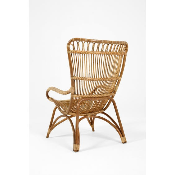 Midcentury aged rattan armchair image