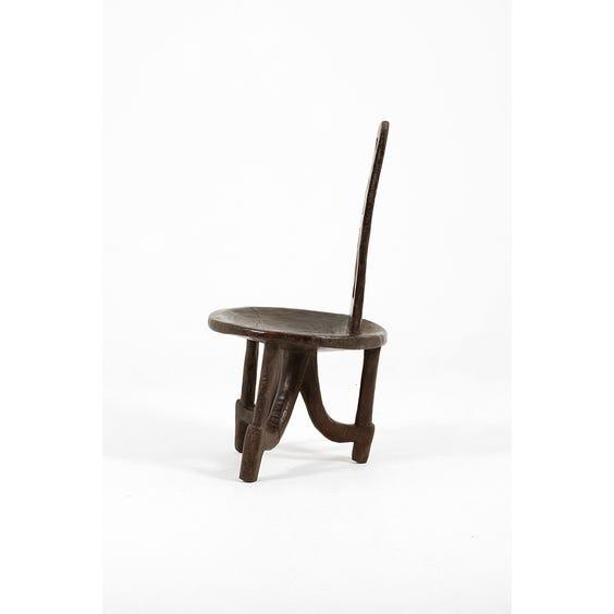 Primitive carved dark wood chair image