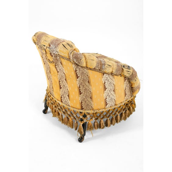 French muted gold and burgundy foliate tub armchair image