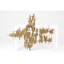 Gold abstract metal wall sculpture