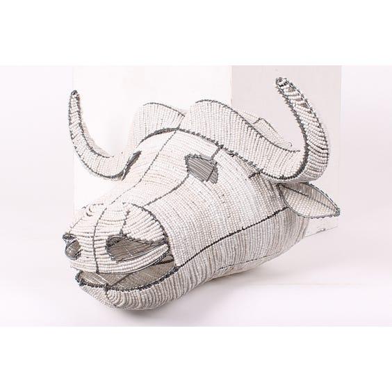 White beaded African buffalo head image