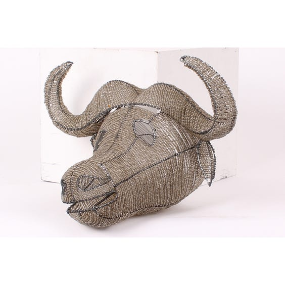Silver beaded African buffalo head image