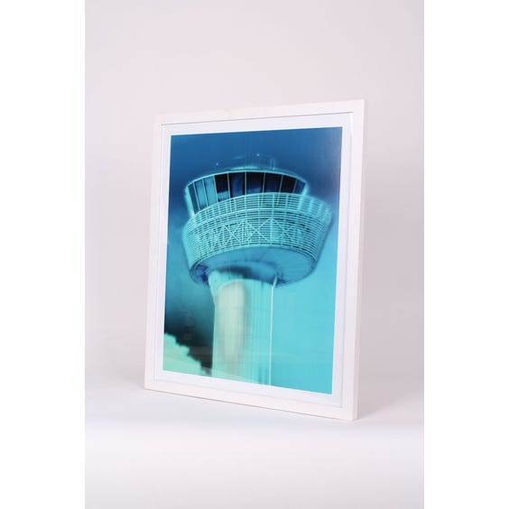 Blue tinted airport tower print image