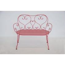 Pink wrought iron garden bench