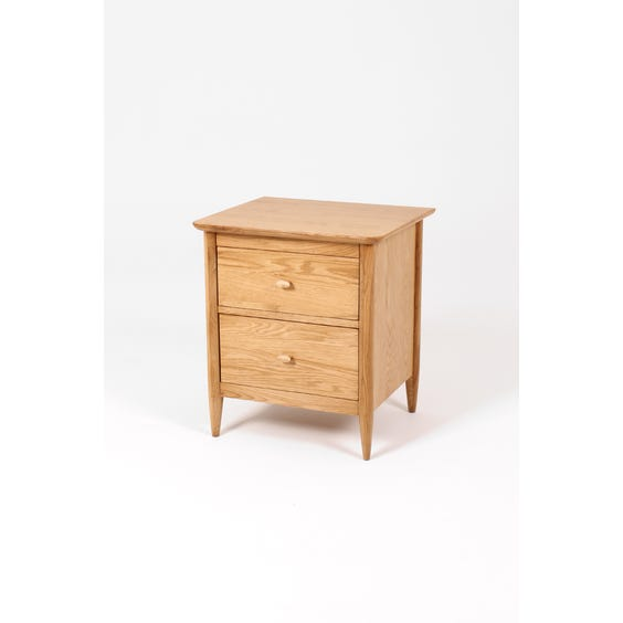 Ercol oak curved bedside table image