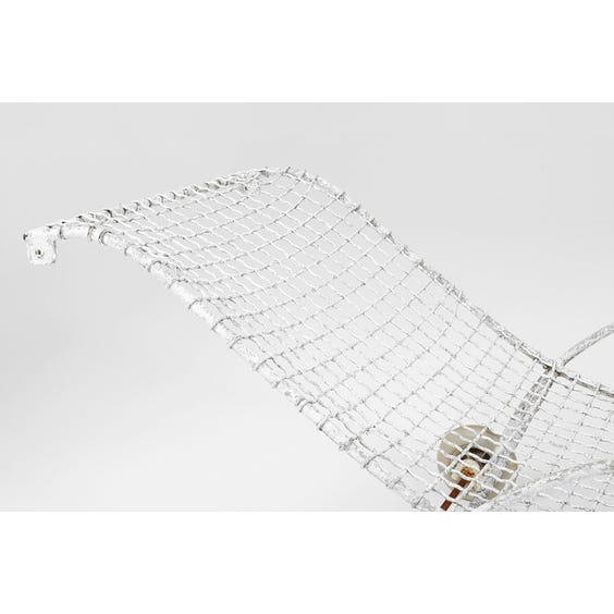 Modernist metal wire sun lounger image