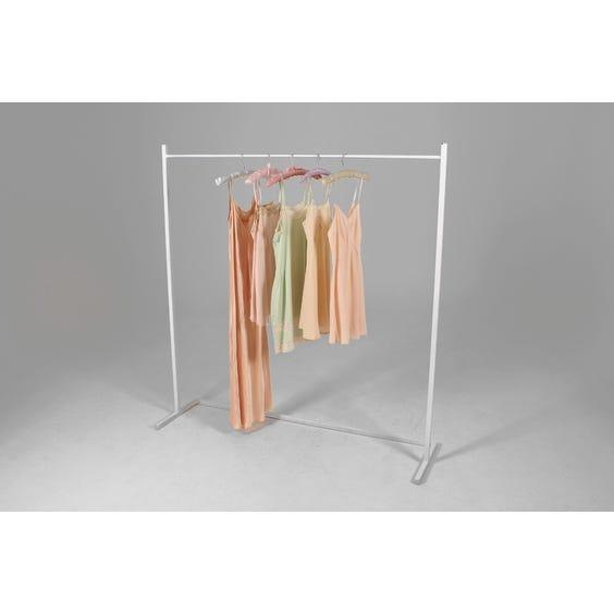 Modern white metal clothes rail image