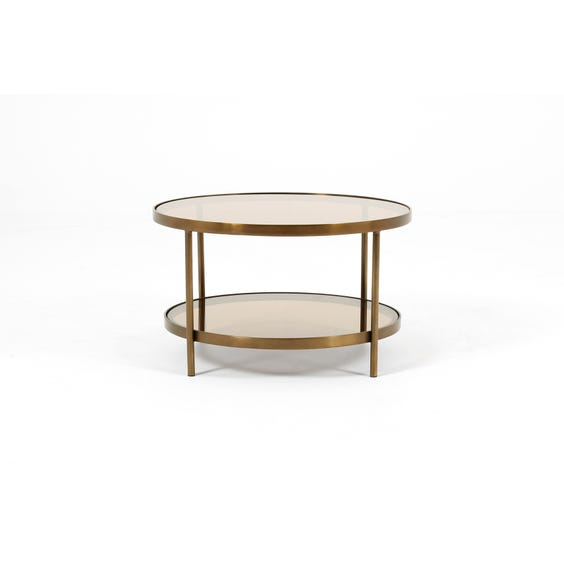 Circular aged brass coffee table image
