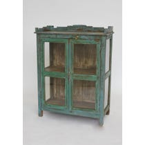 Blue painted crenellated top cabinet