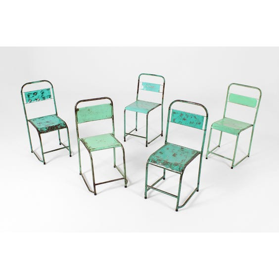 Assorted worn green metal canteen chair image