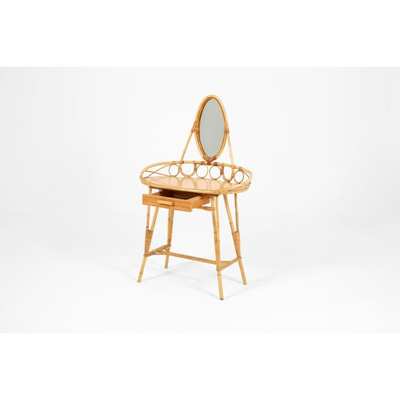 Rattan ellipse shaped dressing table image