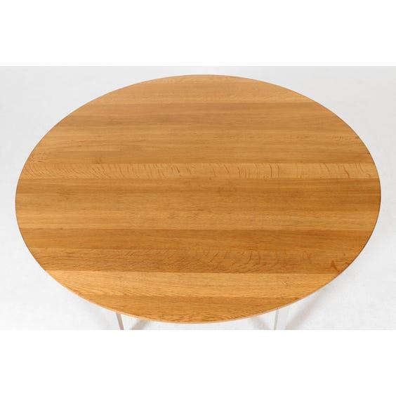 Circular oak top dining table image