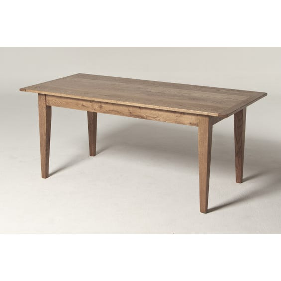Simple oak plank dining table image