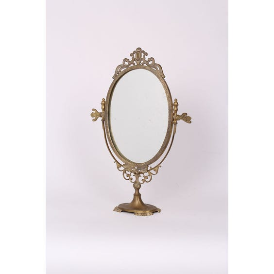 Decorative brass oval mirror image