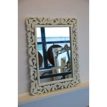 Decoratively carved cream wood mirror