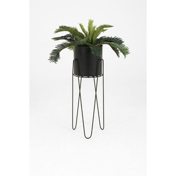 Black metal plant stand image