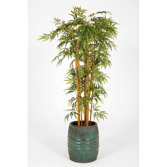 Distressed turquoise barrel planter image