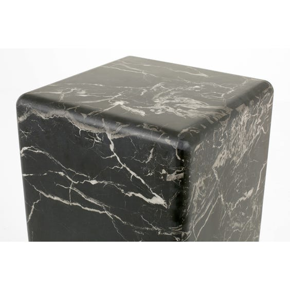 Black faux marble display plinth image