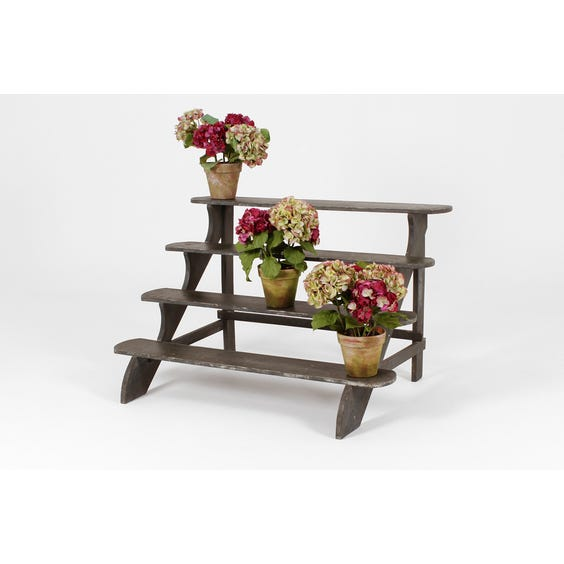Green tiered wooden plant stand image