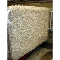 Cream wooly shag pile rug