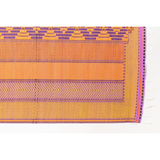 Multi coloured woven plastic rug image