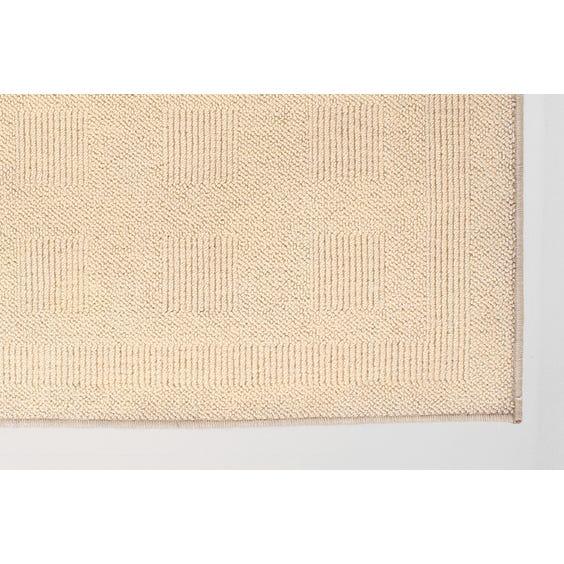 Cream multi-square patterned rug image