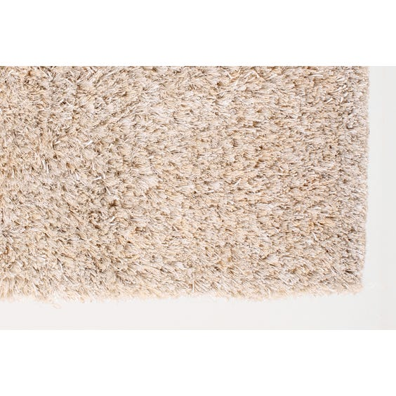 Small cream shag pile rug image