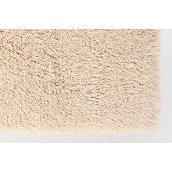 Small natural white Flokati rug image