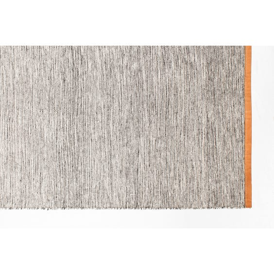 Woven grey and white rug image