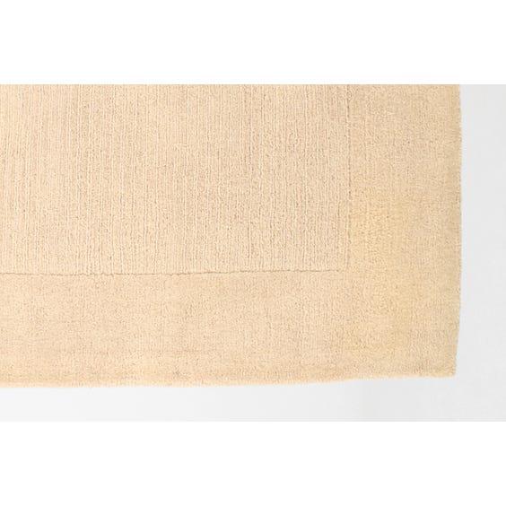 Cream wool rug square insert image
