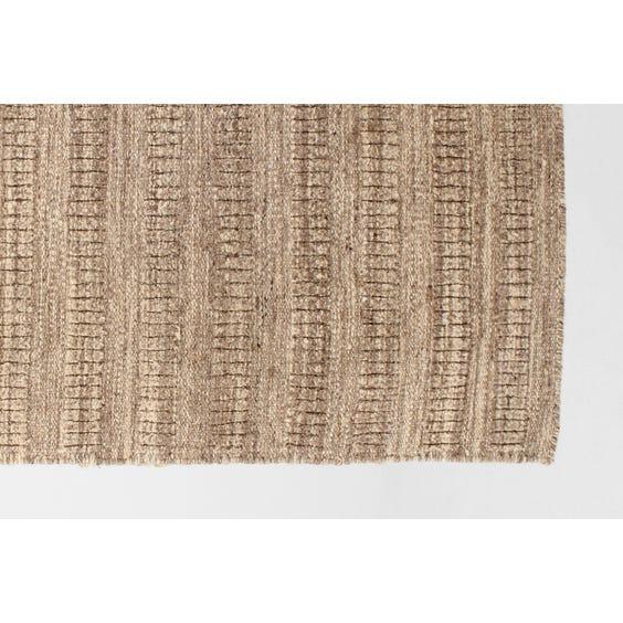 Brown woven flecked wool rug image