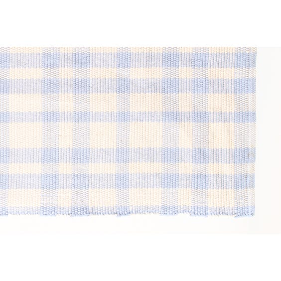 Blue/cream check woven rug image
