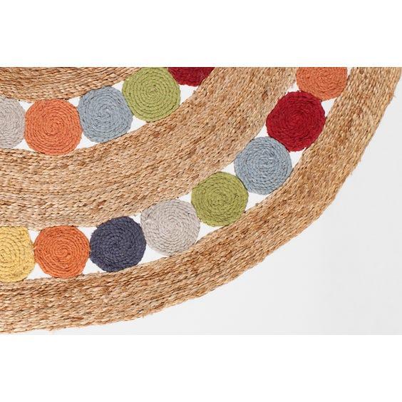 Multi coloured circular straw wool rug image