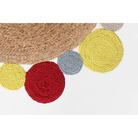 Small multi coloured straw circular rug image