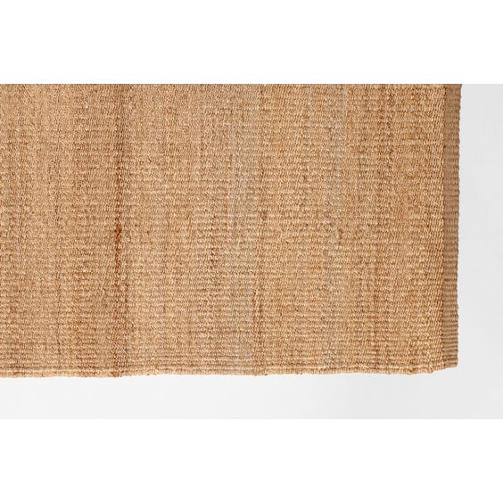 Straw coloured woven hemp rug image
