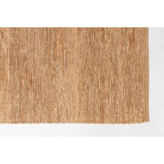 Straw coloured plaited hemp rug image