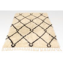Thick Berber style cream rug