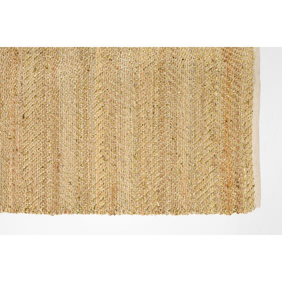 Woven jute and gold rug image