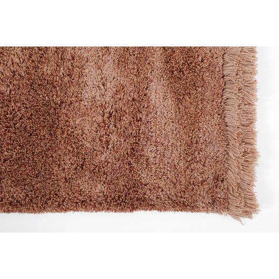 Rusty pink shimmer rug image
