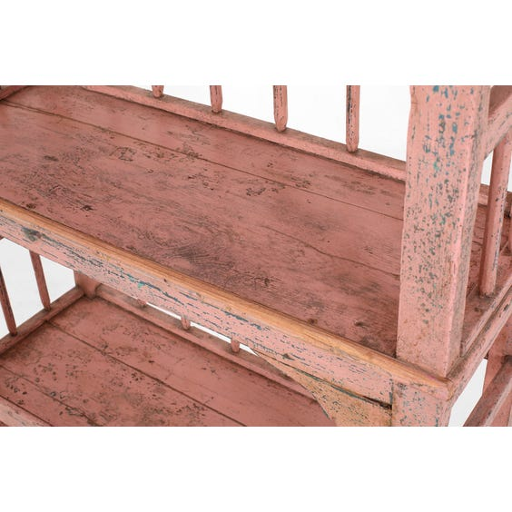 Rustic pink painted shelving unit image