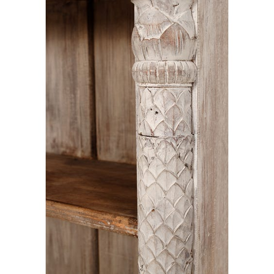 White washed carved bookcase image