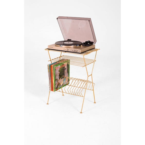 Gold metal record stand image