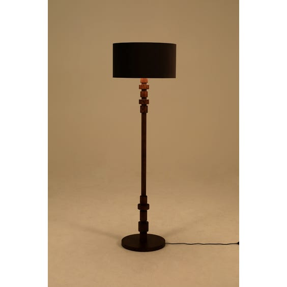Walnut sculptural stacked pole lamp image