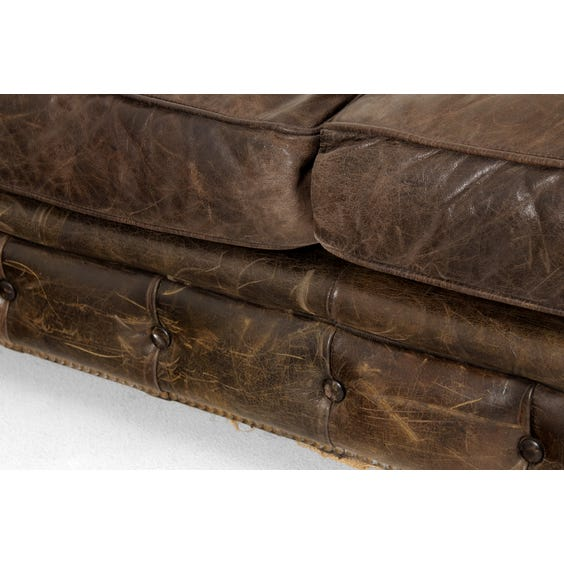 Aged black leather Chesterfield sofa image